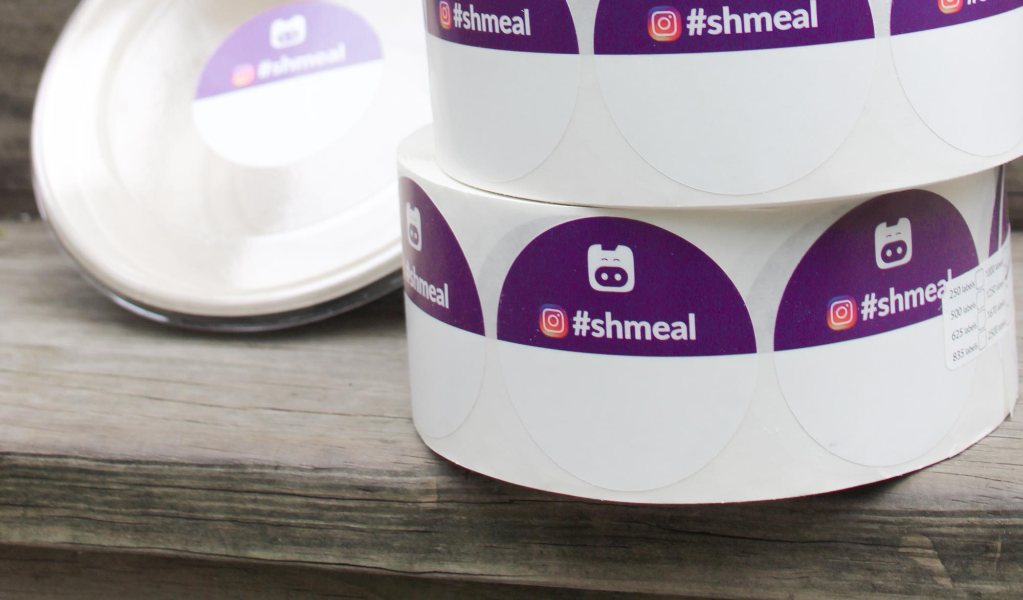 A roll of Shmeal stickers