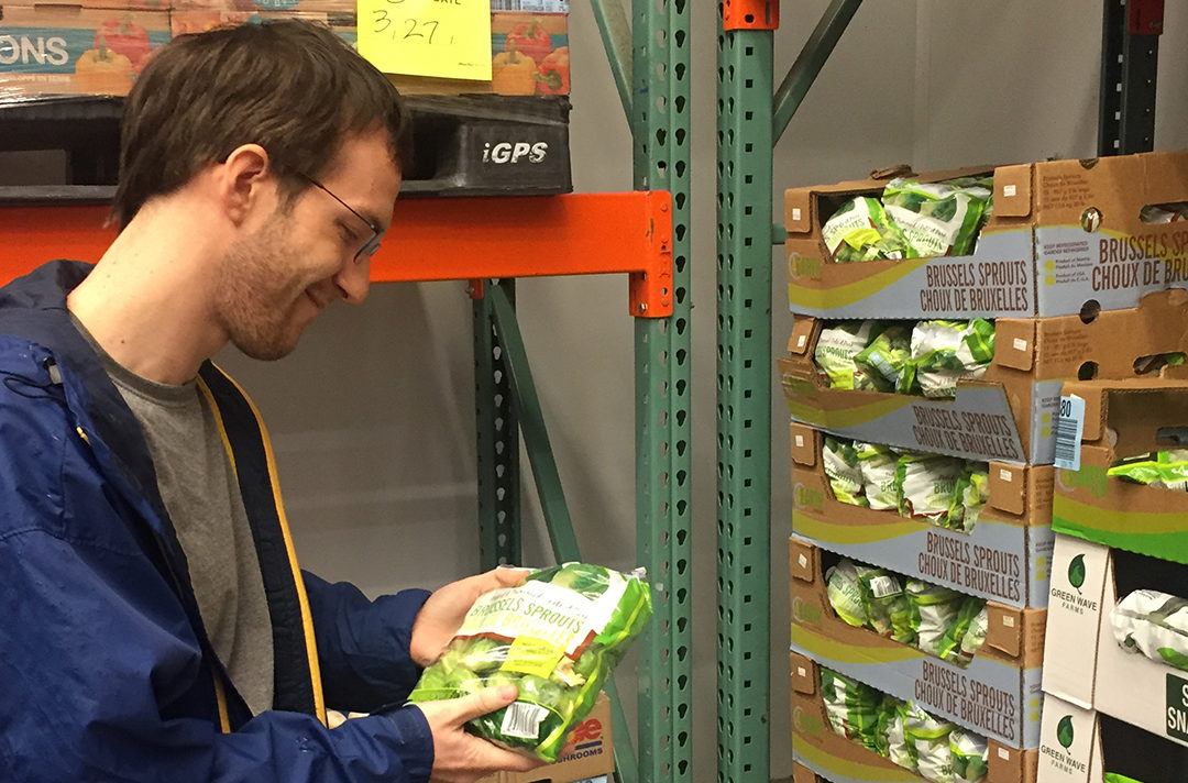 Justin admiring brussels sprouts at Costco