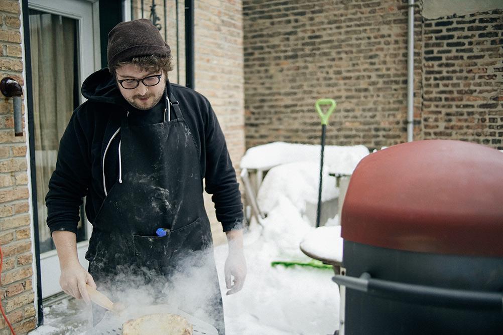 ryan making pizza outside
